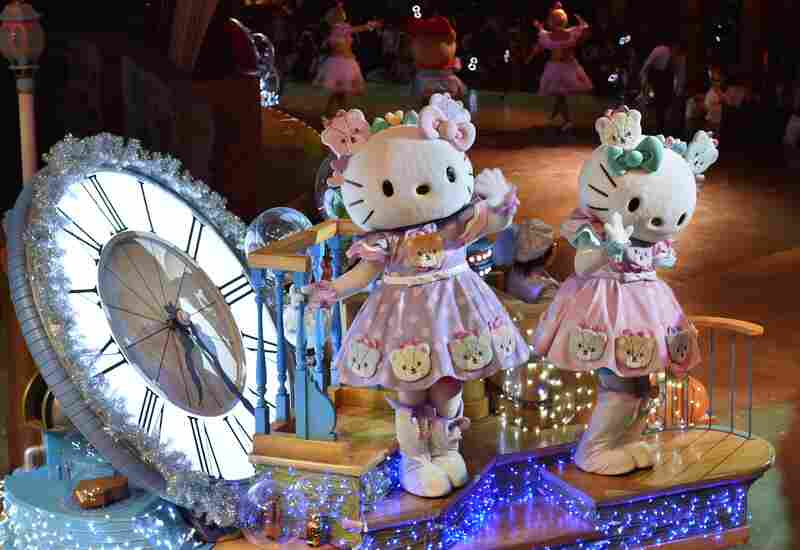 Hello Kitty (left) and her twin sister Mimmy celebrate in the Hello Kitty 40th anniversary parade at Tokyo's Sanrio Puroland.