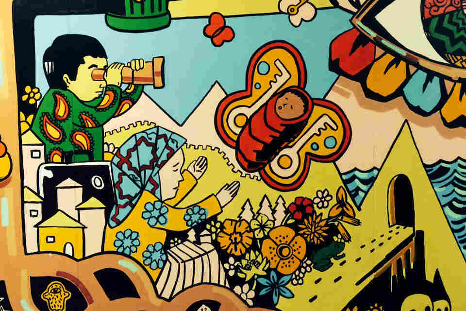 A mural created by students, with help from the artist Angel Garcia, in the hallway at Flushing International High School in New York City.