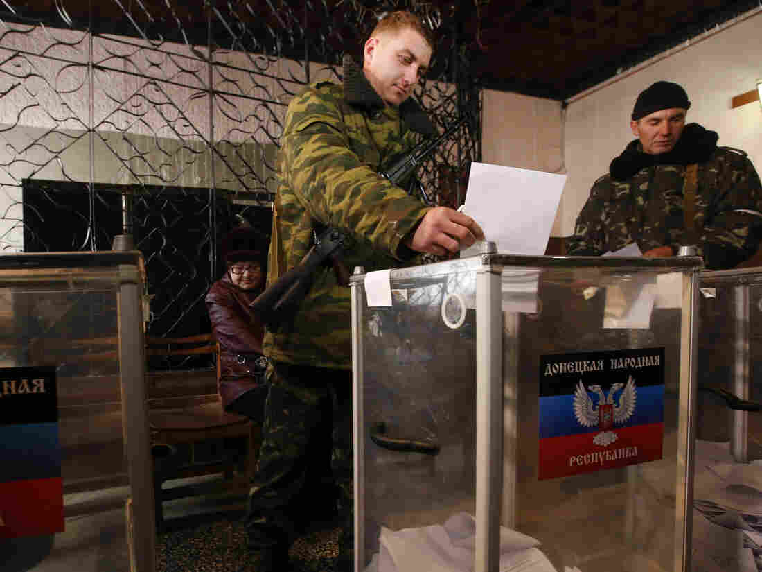 A pro-Russian separatist casts a ballot during the self-proclaimed Donetsk People's Republic leadership and local parliamentary elections at a polling station in the southern coastal town of Novoazovsk on Sunday.