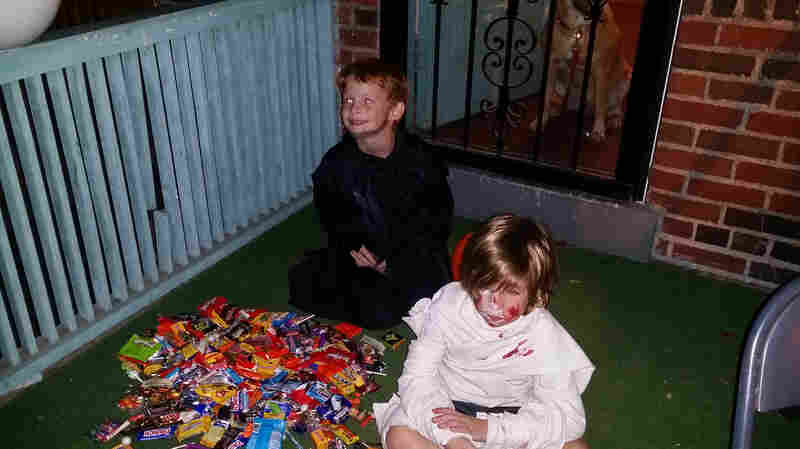 Jake (left) and Will (right) dump out their loot after trick-or-treating.