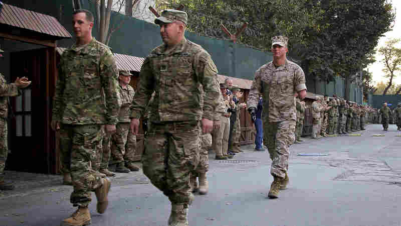 """Four Americans injured in Iraq and Afghanistan visit Kabul as part of Operation Proper Exit, a program designed for wounded warriors. From left, they are Staff Sgt. Ben Dellinger, Capt. Casey Wolfe, Capt. John Urquhart (who is hidden) and Sgt. James """"Eddie"""" Wright."""
