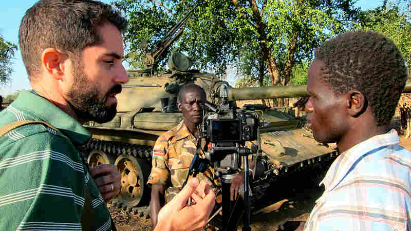 American Ryan Boyette, left, works with Yassin Hassen, right, in an interview with a rebel in Sudan's Nuba Mountains. Boyette started the Nuba Reports website in 2011 and recruited Hassen to join as a citizen journalist.