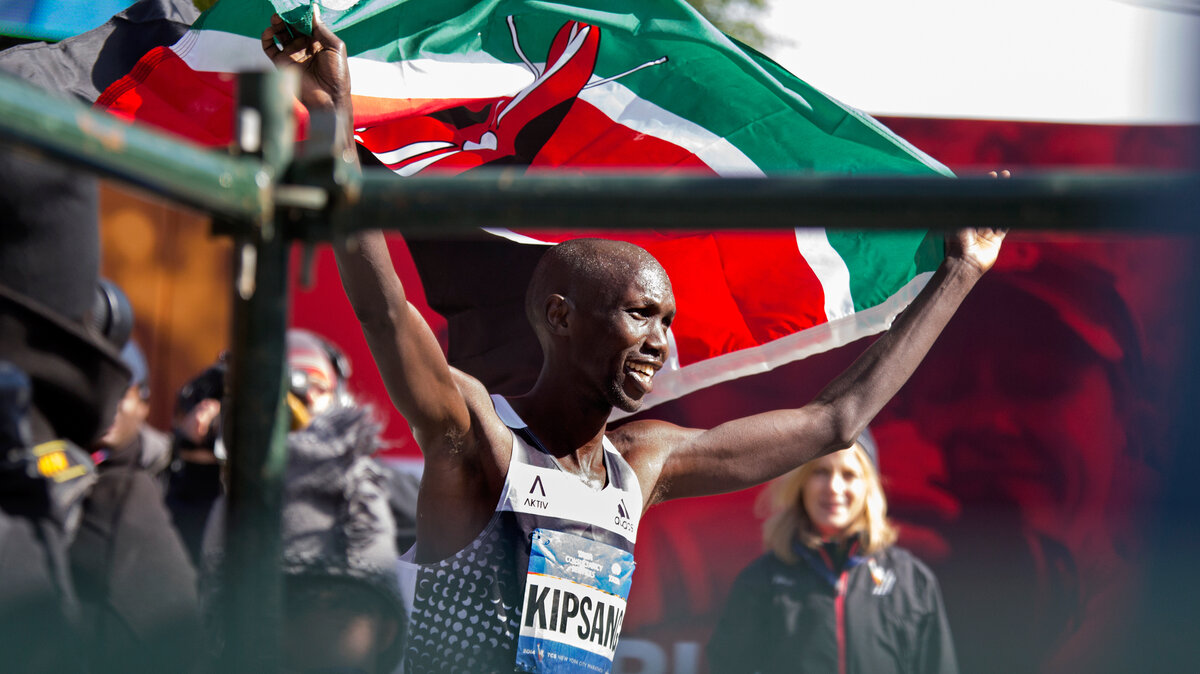 Wilson Kipsang of Kenya hoisted his country's flag after winning the New York City Marathon on Sunday. Kipsang won in an unofficial time of 2 hours, 10 minutes, 59 seconds.