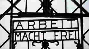 """The entrance to the former concentration camp in Dachau, Germany, bears the Nazi slogan """"Work Makes You Free."""" The gate was stolen over the weekend."""