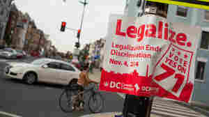 Early results showed more than a 2-1 lead for a measure to make recreational marijuana use legal in Washington, D.C. A sign promoting the initiative is seen on a corner in the Adams Morgan neighborhood Tuesday.