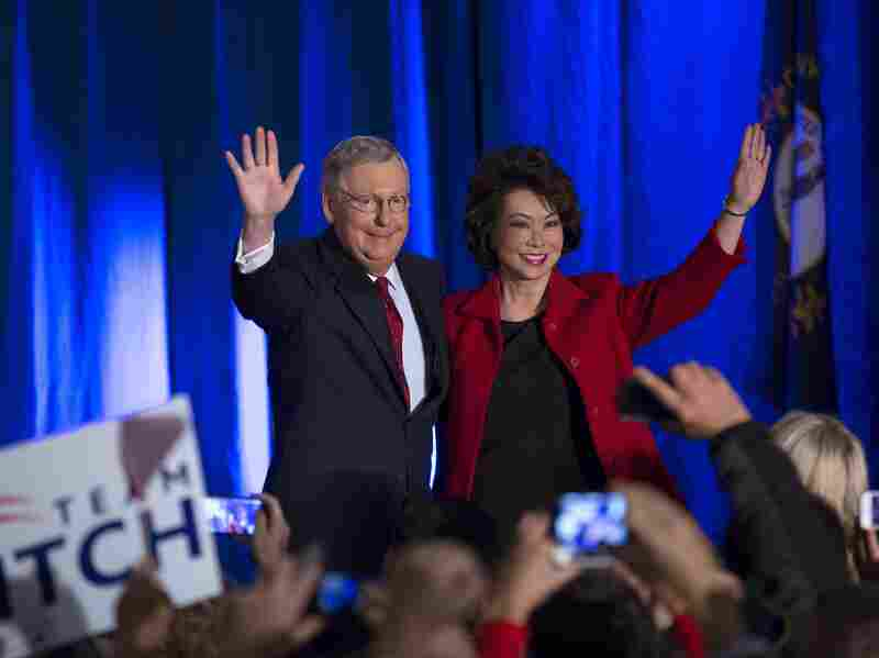 Republican Sen. Mitch McConnell celebrates with his wife, Elaine Chao, on Tuesday in Louisville, Ky. McConnell defeated Kentucky Secretary of State Alison Lundergan Grimes.