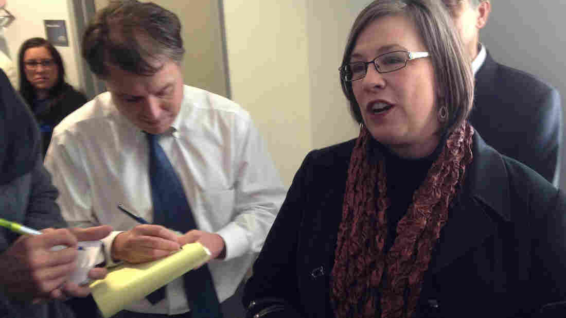 Kansas can't deny same-sex couples' requests for a marriage license, a federal judge ruled Tuesday. Kerry Wilks (right), one of four women represented by the American Civil Liberties Union in a lawsuit against the ban, spoke with reporters after a hearing Friday.