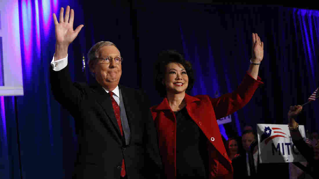 Kentucky Sen. Mitch McConnell arrives at his midterm election night rally with his wife, former U.S. Secretary of Labor Elaine Chao, in Louisville. McConnell, who won re-election, stands to become the next Senate majority leader.