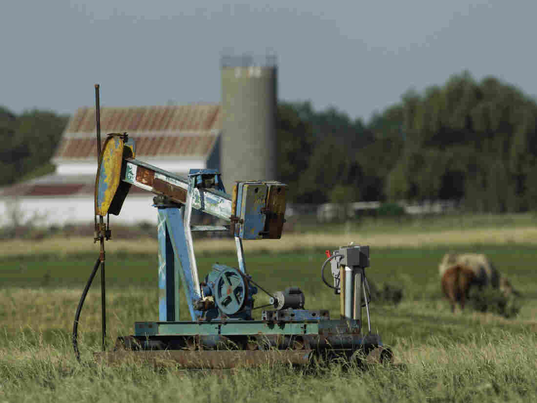 An oil well pumps in a pasture near Rantoul, Kan.