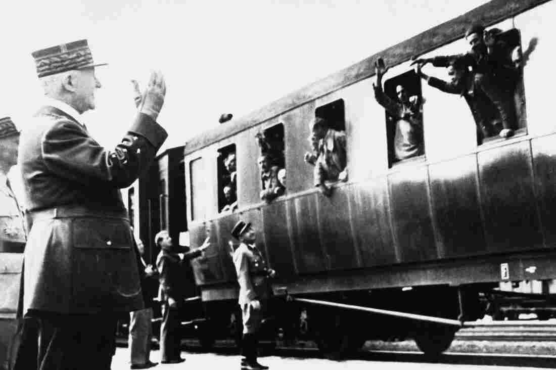 Philippe Petain, head of the French World War II collaborationist government in Vichy, greets French prisoners arriving from Germany in 1941.