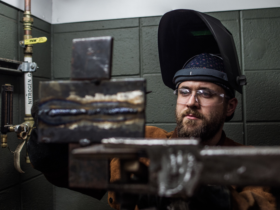 John Harris makes a weld for a test during a welding class at Spartanburg Community College in Spartanburg, S.C., on Oct. 22. (Mike Belleme for NPR)