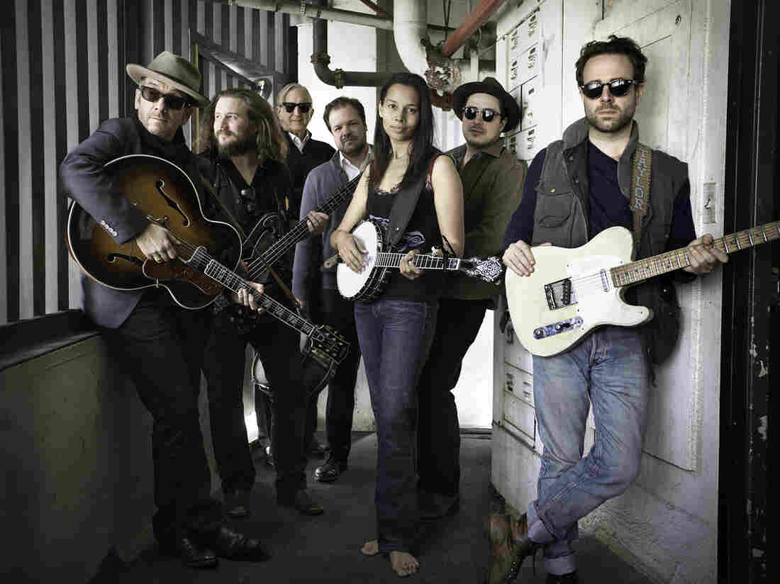 To create Lost on the River: The New Basement Tapes, T Bone Burnett (third from left) assembled the talents of Elvis Costello, Jim James, Jay Bellerose, Rhiannon Giddens, Marcus Mumford and Taylor Goldsmith.