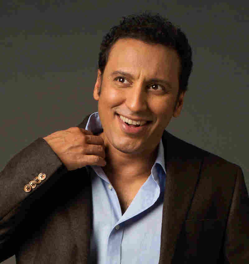 Aasif Mandvi, best known as The Daily Show's senior Muslim correspondent, has written a new book called No Land's Man.