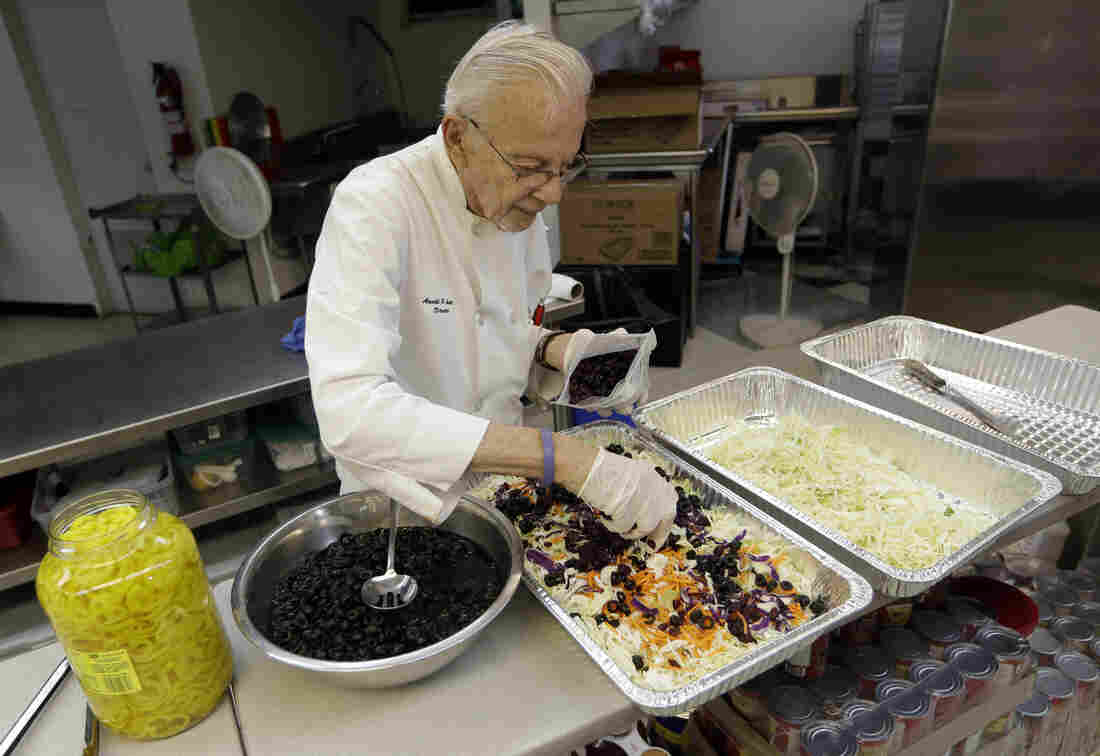 Homeless advocate Arnold Abbott, 90, director of the nonprofit group Love Thy Neighbor Inc., prepares a salad Wednesday in the kitchen of The Sanctuary Church in Fort Lauderdale, Fla. Abbott was recently arrested, along with two pastors, for feeding the homeless in a Fort Lauderdale park.