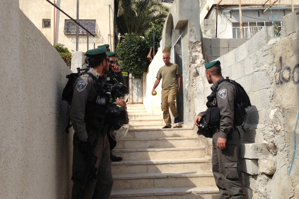 Israeli police stand near a residence in East Jerusalem where Israeli Jews have bought apartments in the predominantly Palestinian neighborhood of Silwan. The Palestinian seller said he sold the apartment to a Palestinian middleman and did not realize the ultimate owner was Jewish.