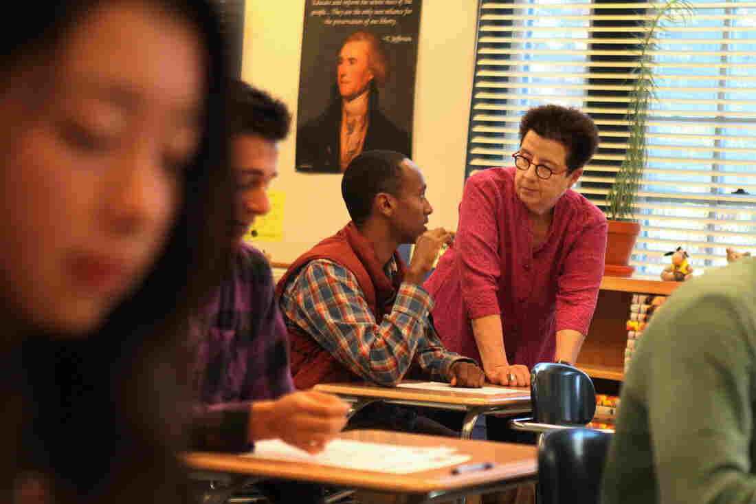 Maryann Wolfe talks with Mawi Fasil during her AP American government class at Oakland Technical High School.