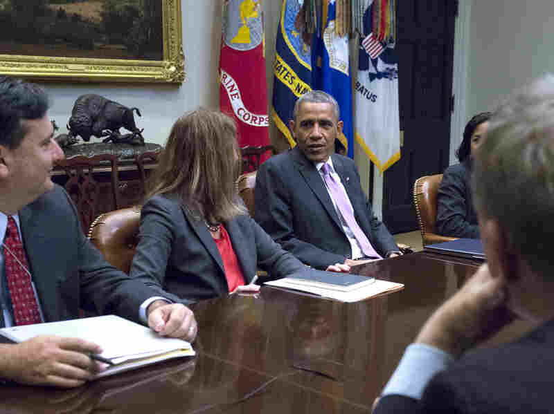President Barack Obama meets with Ebola Response Coordinator Ron Klain (left), Health and Human Services Secretary Sylvia Burwell (center) and members of his national security and public health teams to receive an update on the Ebola response in the Roosevelt Room of the White House in D.C. on Nov. 4th, 2014.