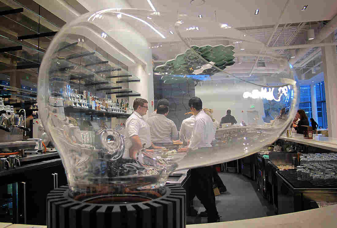 Le Laboratoire Cambridge features a restaurant, the Cafe ArtScience. The restaurant's bar features a glass-globed drink vaporizer called Le Whaf.