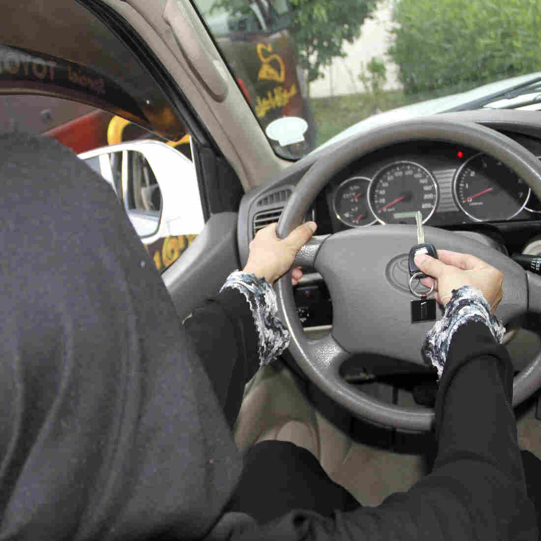 A Saudi woman poses in this picture to illustrate driving a car in Jiddah as part of a June 2011 protest. An advisory council has recommended for the first time lifting a ban on female drivers.