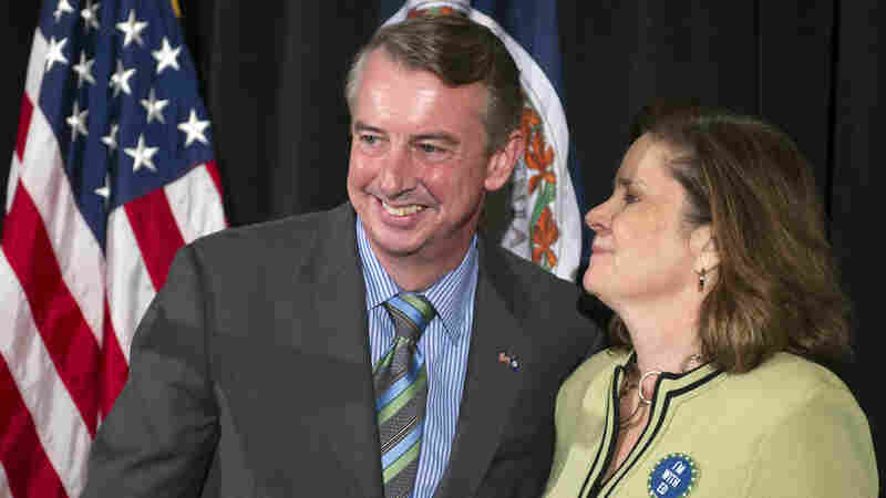 Virginia Republican Senate candidate Ed Gillespie, accompanied by his wife, Cathy, concedes in his Virginia Senate race against the Democratic incumbent, Sen. Mark Warner, on Friday in Springfield, Va.