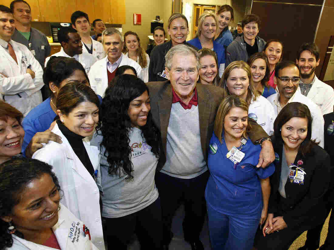 The monitoring for potential cases of the deadly Ebola virus ends Friday in Dallas. Former President George W. Bush poses with staff at Texas Health Presbyterian Hospital, celebrating the milestone.