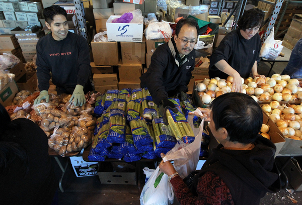 Volunteers pass out fresh vegetables for a Thanksgiving meal at the Alameda Food Bank in Alameda, Calif., in 2009. The percentage of Americans who report struggling to afford food has remained stubbornly near recession-era highs.