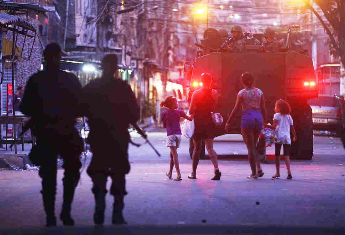 Brazilian navy soldiers in a tank enter Mare on March 30, as part of the government's pacification program to rid the favelas of drug gangs and violence.