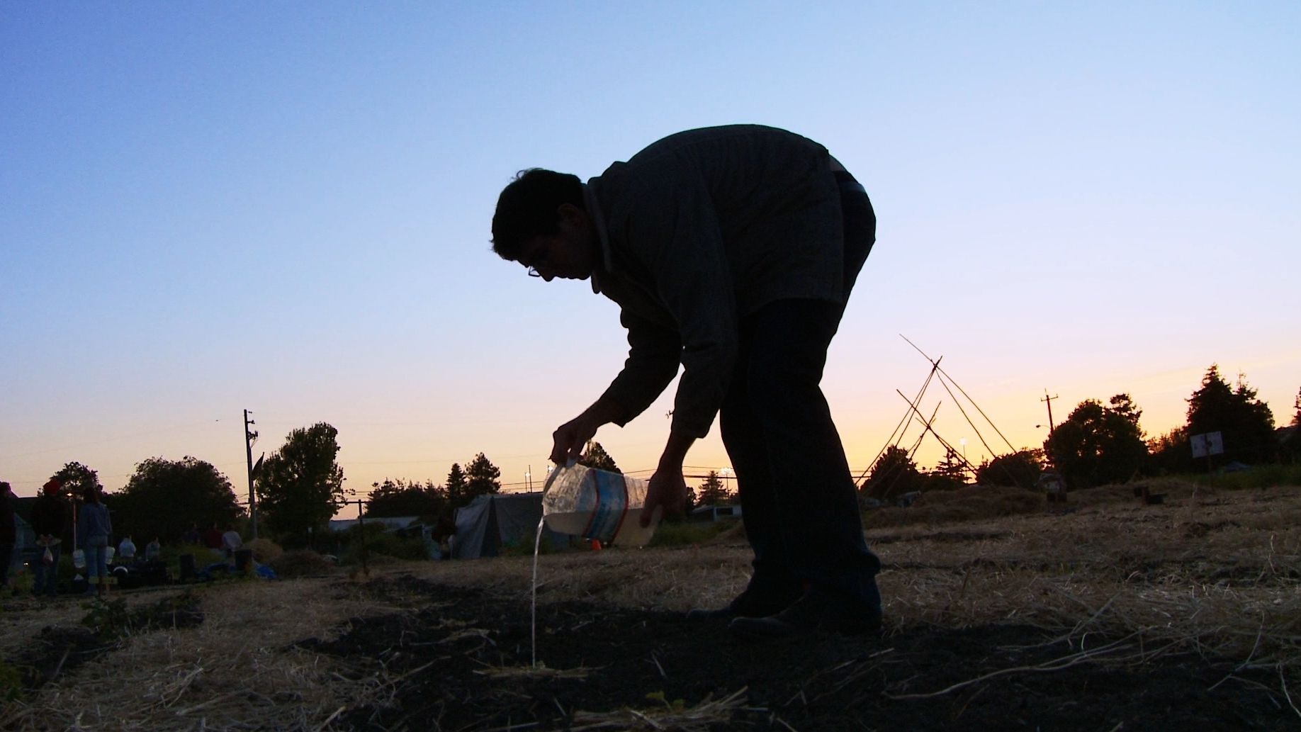occupy-the-farm_poster-image-watering-at-sundown_wide ...