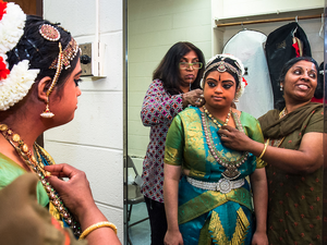 Hema Ramaswamy prepares backstage for her performance. She studied with Chitra Venkateswaran (right) in preparation for this recital for four and a half years.