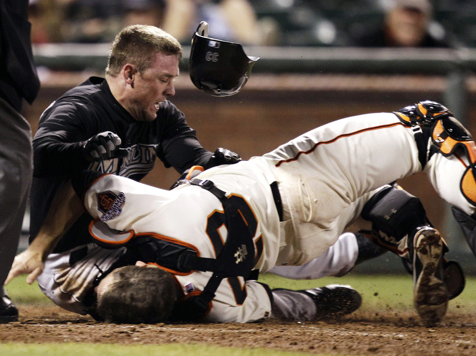 A 2011 collision that left San Francisco Giants catcher Buster Posey with a broken leg sparked an MLB debate about preventing injuries. Many collisions have caused head injuries, but a bigger risk to catchers is foul tips. (Marcio Jose Sanchez/AP)