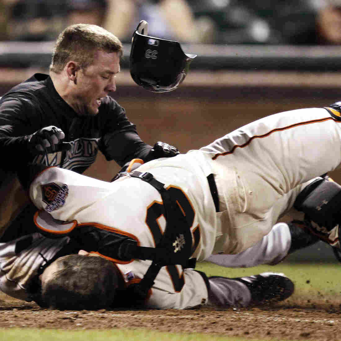 A 2011 collision that left San Francisco Giants catcher Buster Posey with a broken leg sparked an MLB debate about preventing injuries. Many collisions have caused head injuries, but a bigger risk to catchers is foul tips.