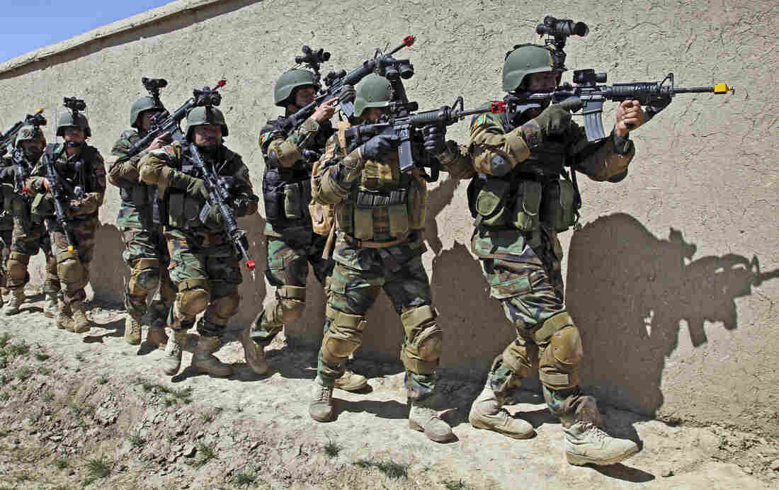 """Afghan special forces train for a hostage rescue operation in this 2012 photo. Campbell, the top U.S. commander, says the Afghan army has """"the capability to protect itself and is the strongest institution in the country."""""""