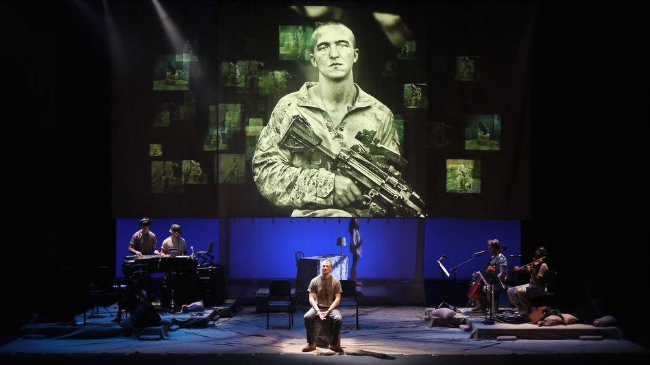 <em>BASETRACK Live</em> incorporates photographs, videos and interviews to tell the story of warfare, both at home and abroad. (Courtesy of En Garde Arts)
