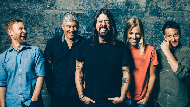 Dave Grohl, center, with The Foo Fighters (Brantley Gutierrez)