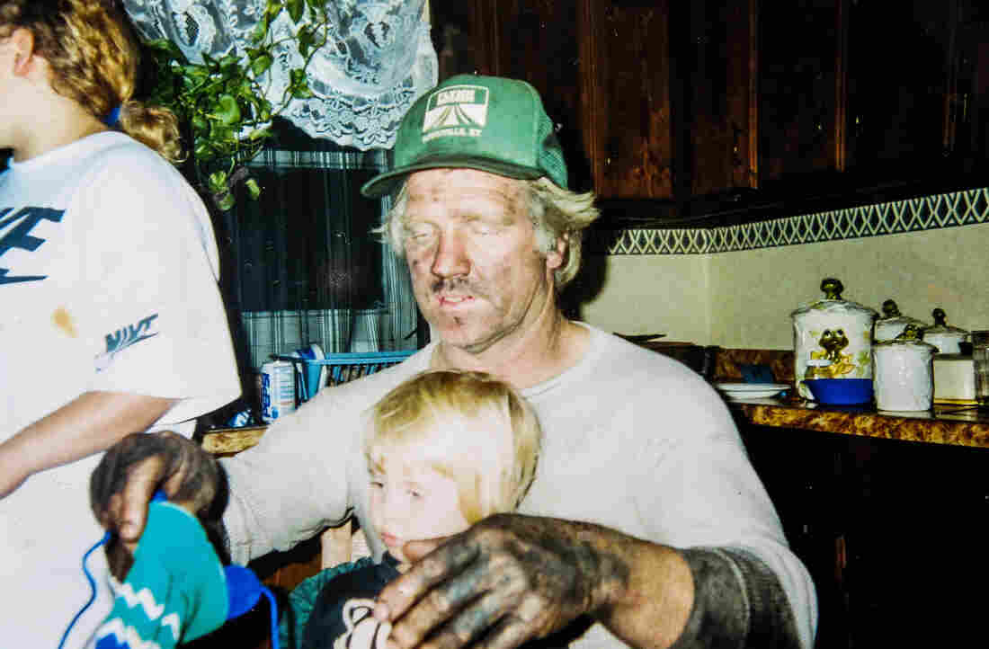 Rome Meade in his younger days relaxing at home after a shift working as an underground coal miner. Meade worked as a coal miner for 40 years until his death in 2009.