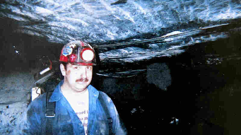 This photo of Roy Middleton working underground at the Kentucky Darby mine now sits on the mantel in the Middleton home in Harlan County, Ky. He was killed after an explosion in 2006.