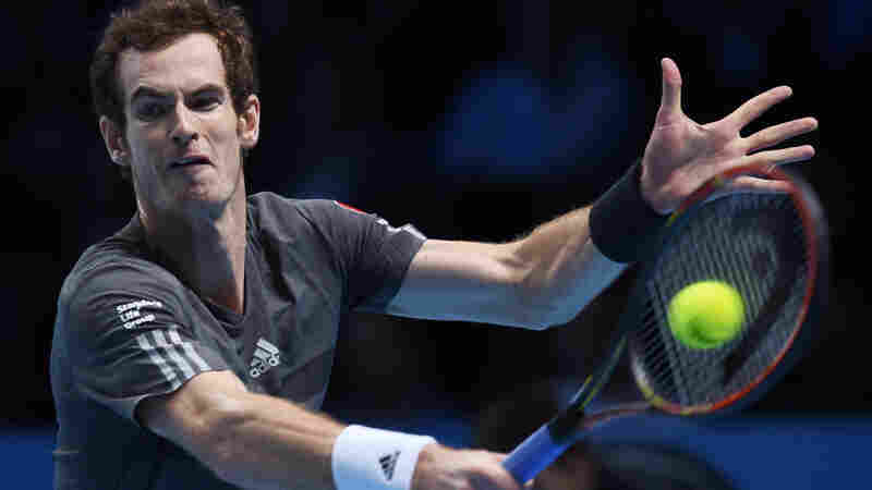 Britain's Andy Murray plays a return to Canada's Milos Raonic during their singles ATP World Tour tennis finals match Tuesday at the O2 arena in London.
