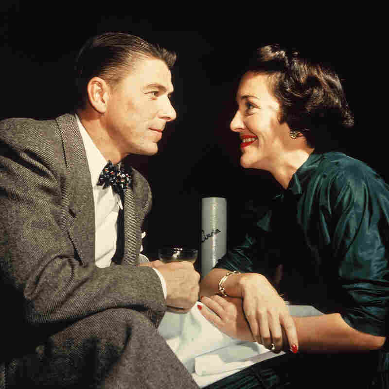 Actor Ronald Reagan and his wife, Nancy, gaze at one another across a table in 1952.