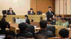 Sewol ferry crew members, whose identities are obscured in this photo at the request of the court, attend verdict proceedings in Gwangju, South Korea, Tuesday. Ferry captain Lee Joon-Seok was sentenced to 36 years in jail.