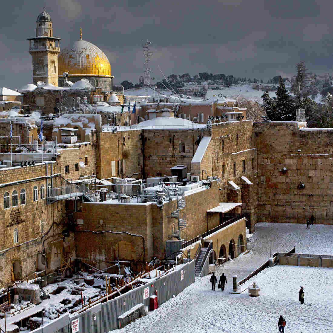 The gilded Dome of the Rock is part of the most important Muslim holy site in Jerusalem, while the Western Wall, in the midground on the right, is the holiest place for Jewish prayer. The photo was taken following a rare snowstorm in Jerusalem in December 2013.