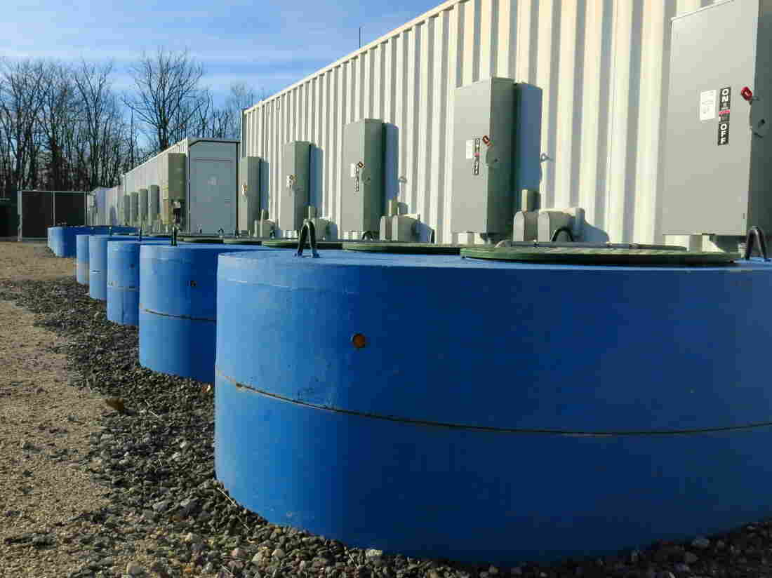 Beacon Power's plant in Hazle Township, Pa., stores electricity for brief periods, making it easier for the local power grid to integrate intermittent forms of renewable generation, such as wind and solar. Flywheels located in the blue cylinders store energy and operate like a battery — pulling in power from the grid when there's too much and releasing it back out when there's not enough.