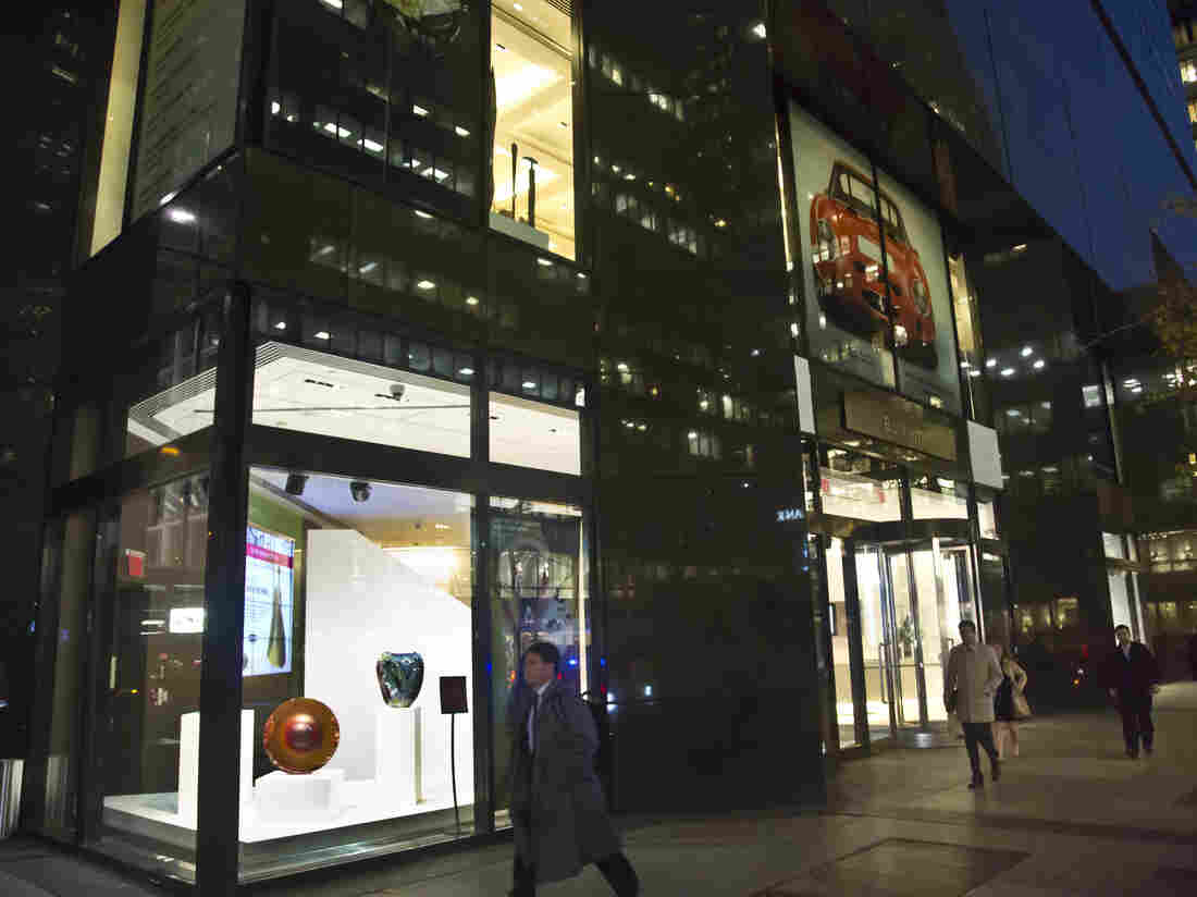 Pedestrians pass the display windows at Bonhams New York auction house. The Mexican government accuses Bonhams of auctioning off artifacts that were stolen from Mexico, and says others that were offered as ancient were modern fakes.