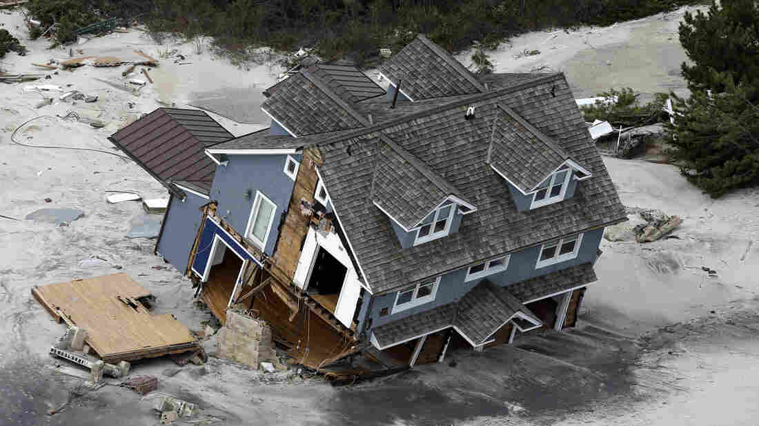 "A house on the central Jersey Shore coast collapsed after Superstorm Sandy hit in 2012. Richard Ford said he focused on houses in the wake of the storm in his new book, Let Me Be Frank With You, because they have an ""almost iconic status."" ""A house is where you look out the window and see the world,"" he says."
