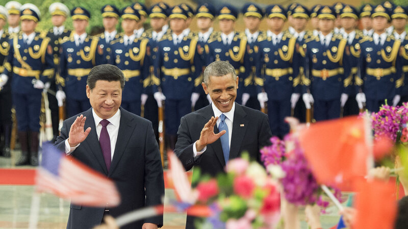 Chinese President Xi Jinping and President Obama, seen here during a ceremony at the Great Hall of the People in Beijing, announced pledges to reduce greenhouse gases.