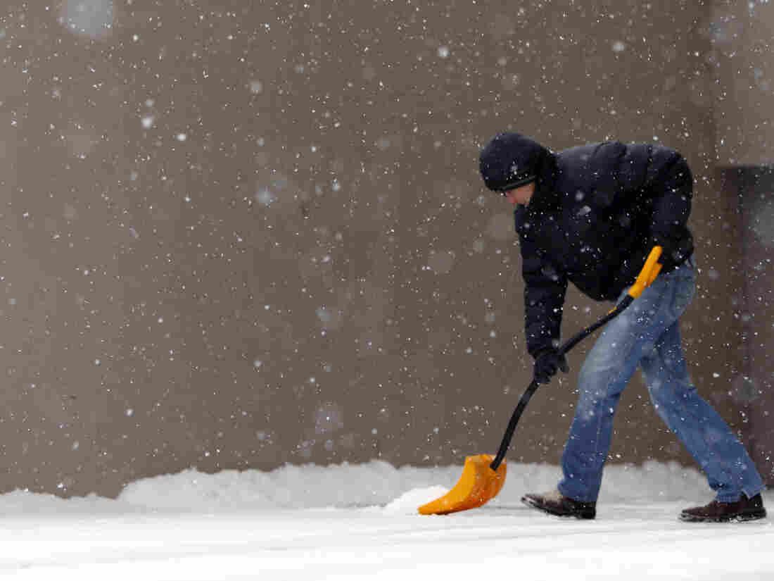 In Denver, Cole Baldock shovels snow on Wednesday morning.
