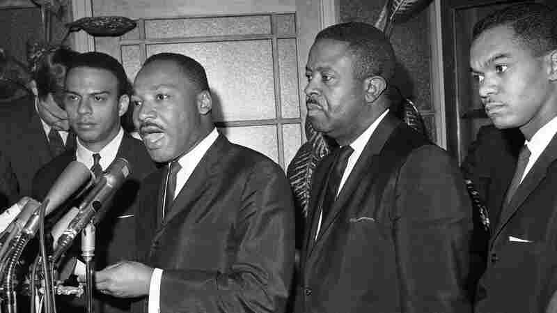 The Rev. Martin Luther King makes a statement at the Justice Department in Washington on Dec. 1, 1964 after a meeting with FBI Director J. Edgar Hoover. Under Hoover's leadership, the FBI investigated King and his personal life for years.