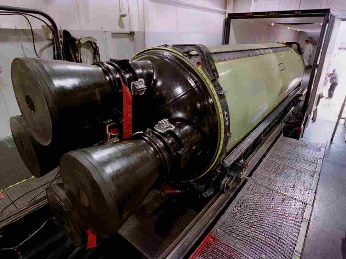 A Minuteman III missile engine is loaded into a truck for transport to another building for X-raying before being torn down and rebuilt. The Air Force's missile command-and-control structure has been the subject of several recent scandals.