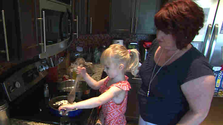 Sherri Erkel and her daughter, Asa, cook dinner in their kitchen in Iowa City, Iowa. The Erkel family is part of an EPA study measuring the amount of food wasted in U.S. homes.