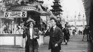 One of America's favorite bites: the hotdog. Here, a man and women enjoy the dogs at a California fair in 1905.