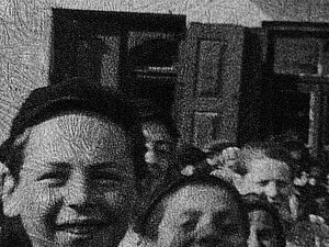 In a still from the 1938 film footage, 13-year-old Morris Chandler appears on the left, among other town children.